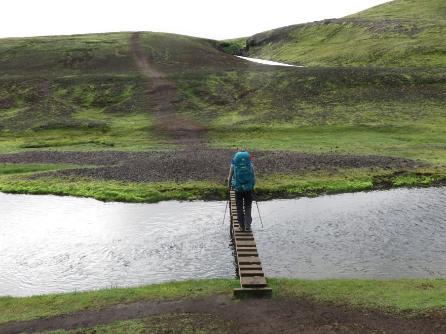 Hiker crossing water
